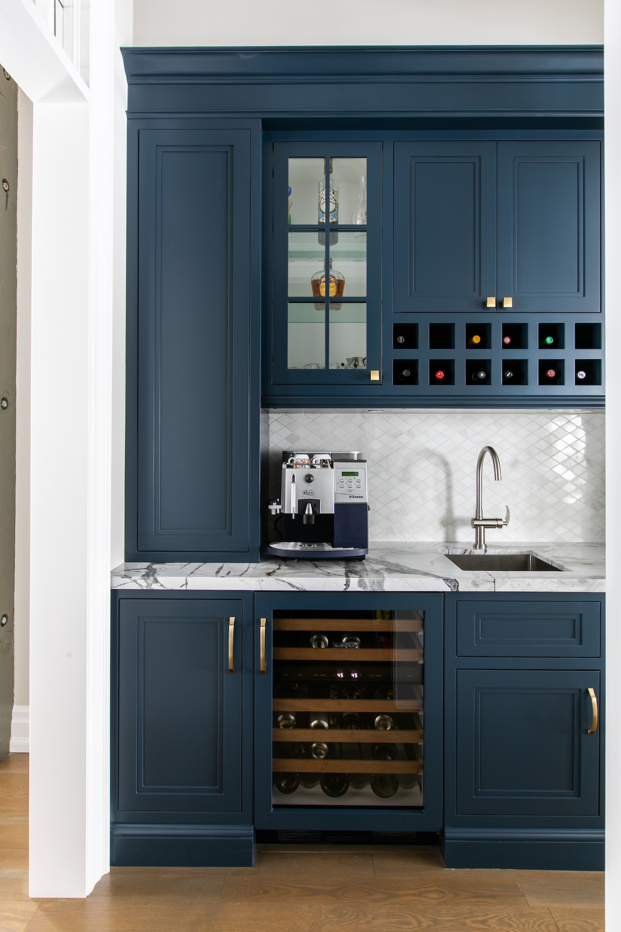 Blue kitchen cabinets and white counter