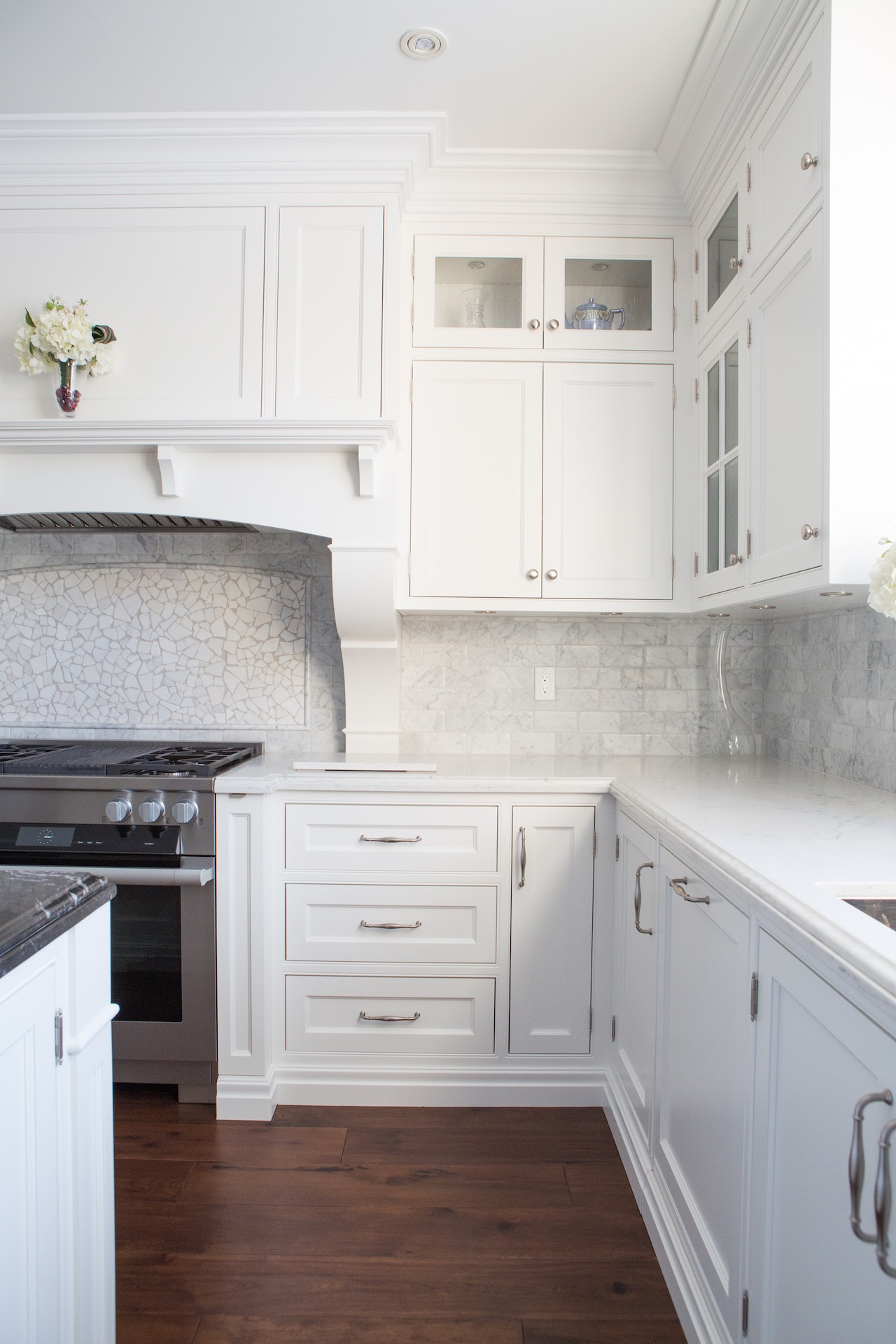 white kitchen cabinets and wood floor