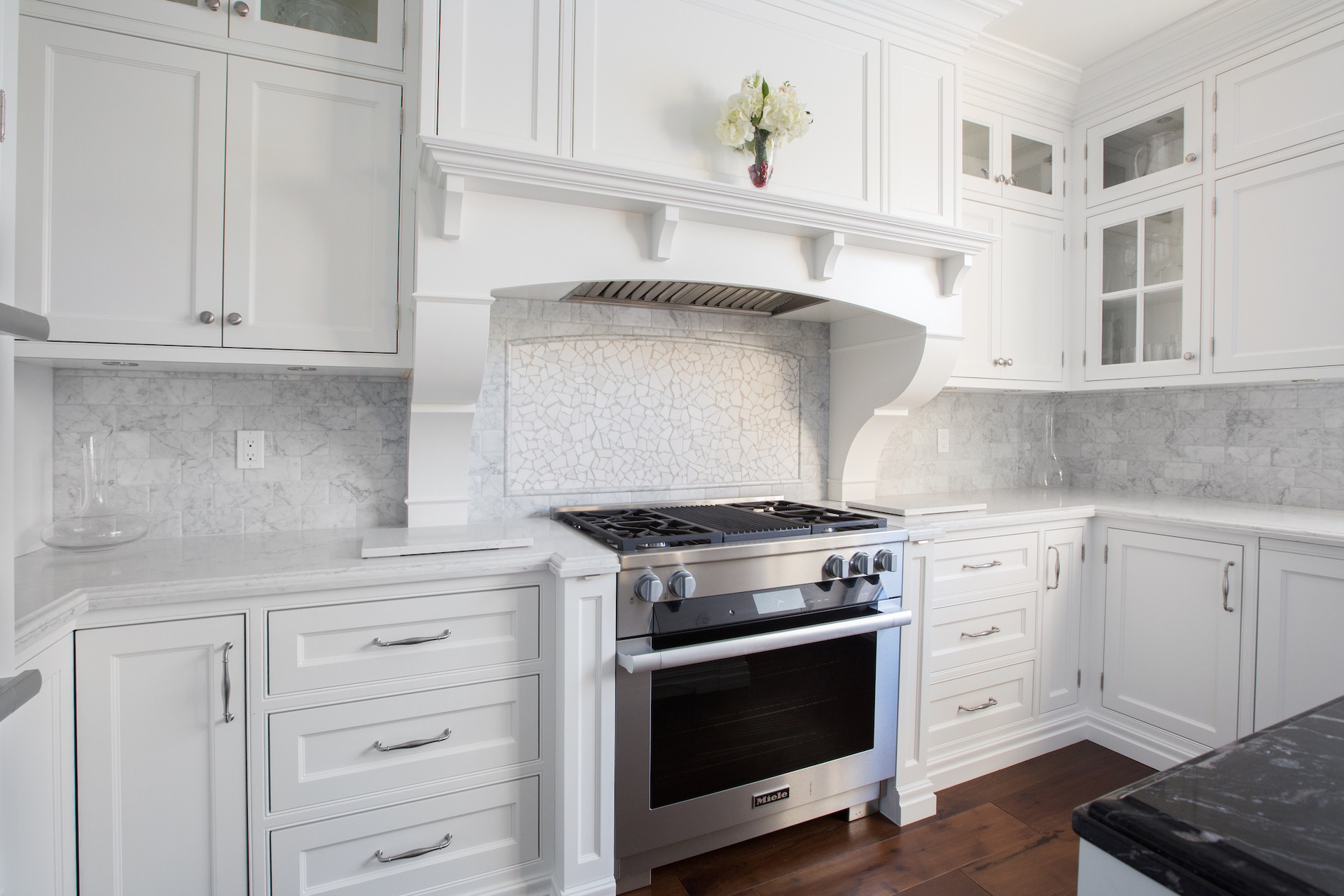 White cabinets with stove and oven