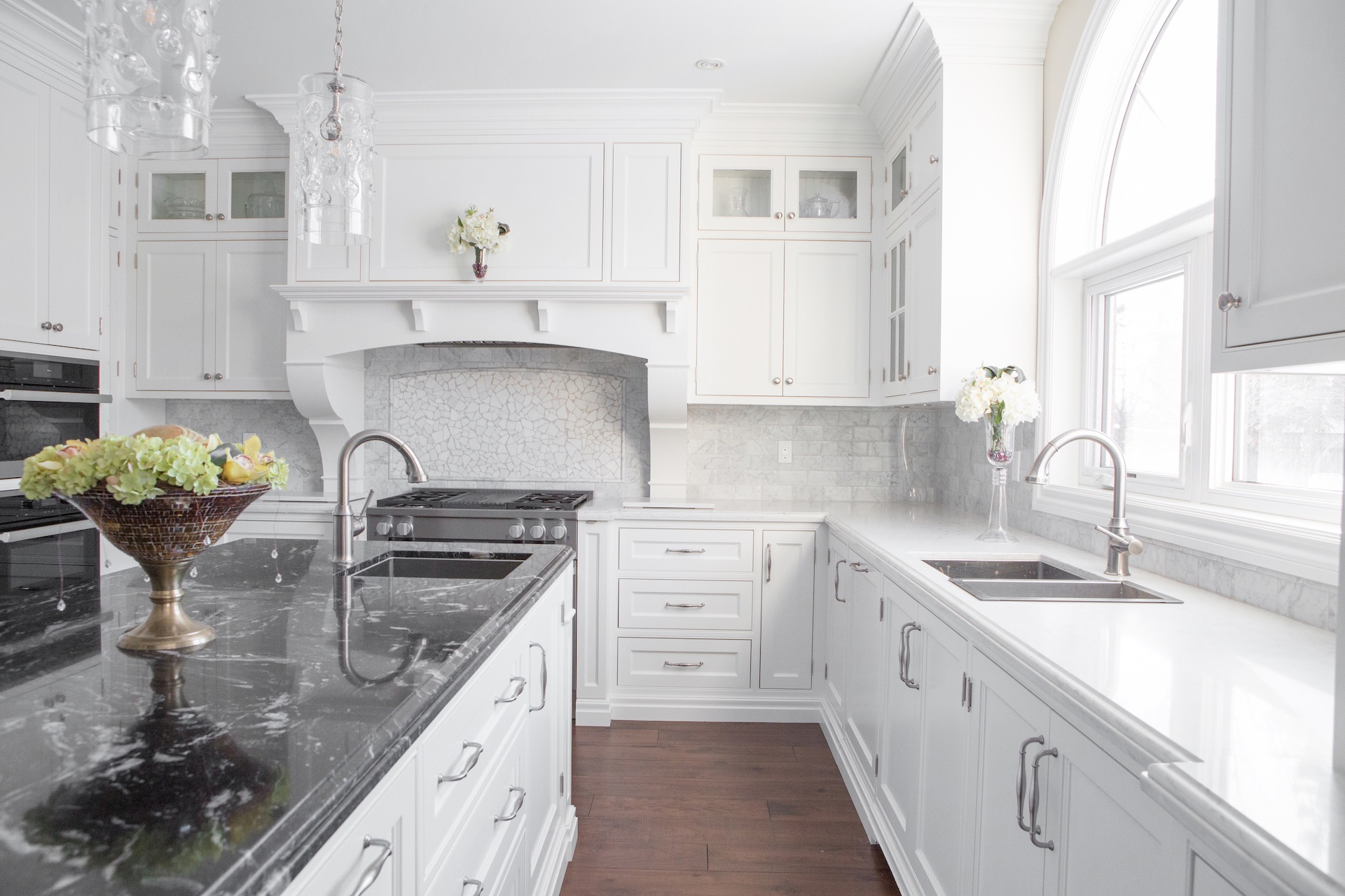 White kitchen with black counter top