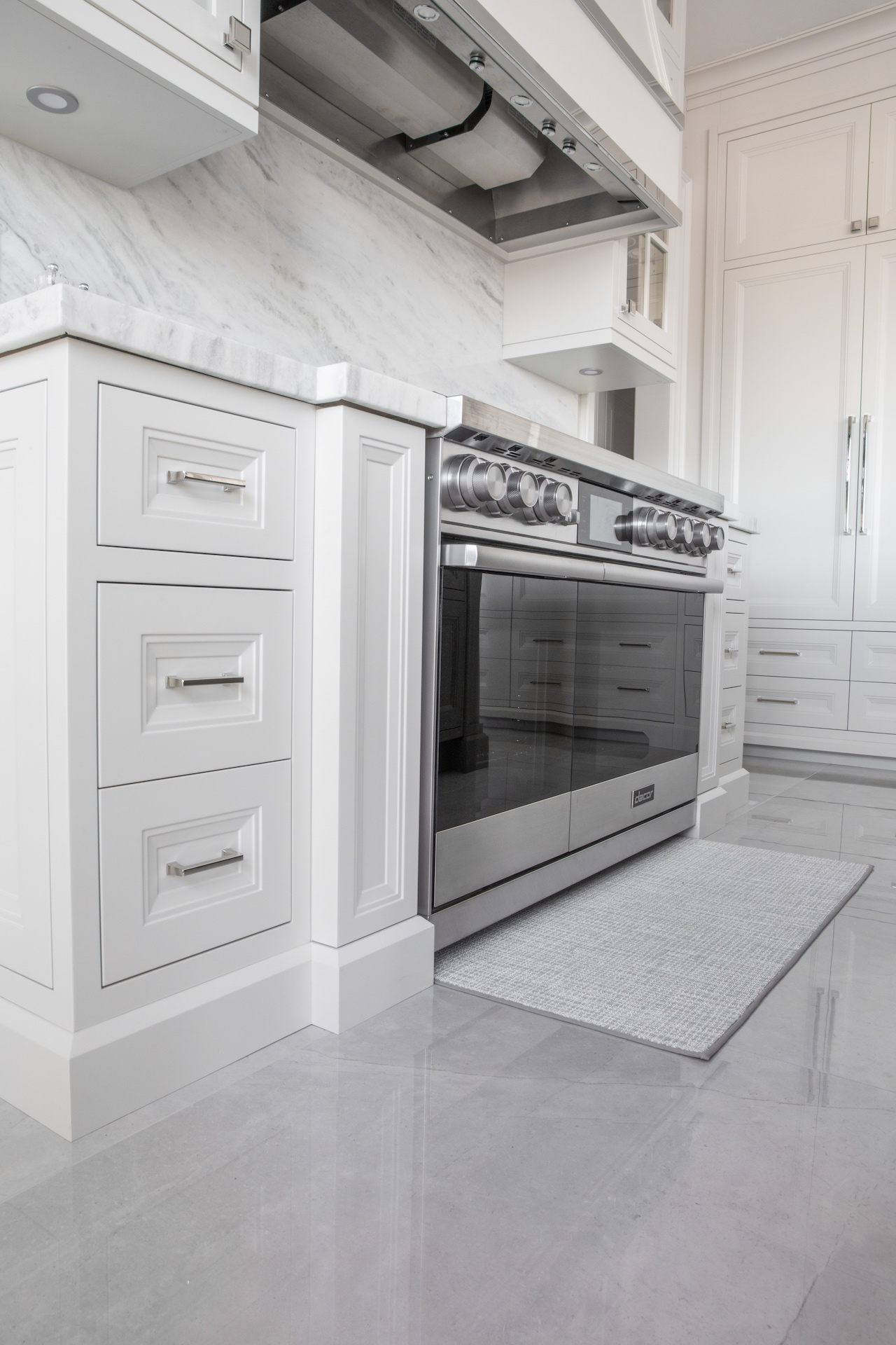 White kitchen drawers with stove and oven
