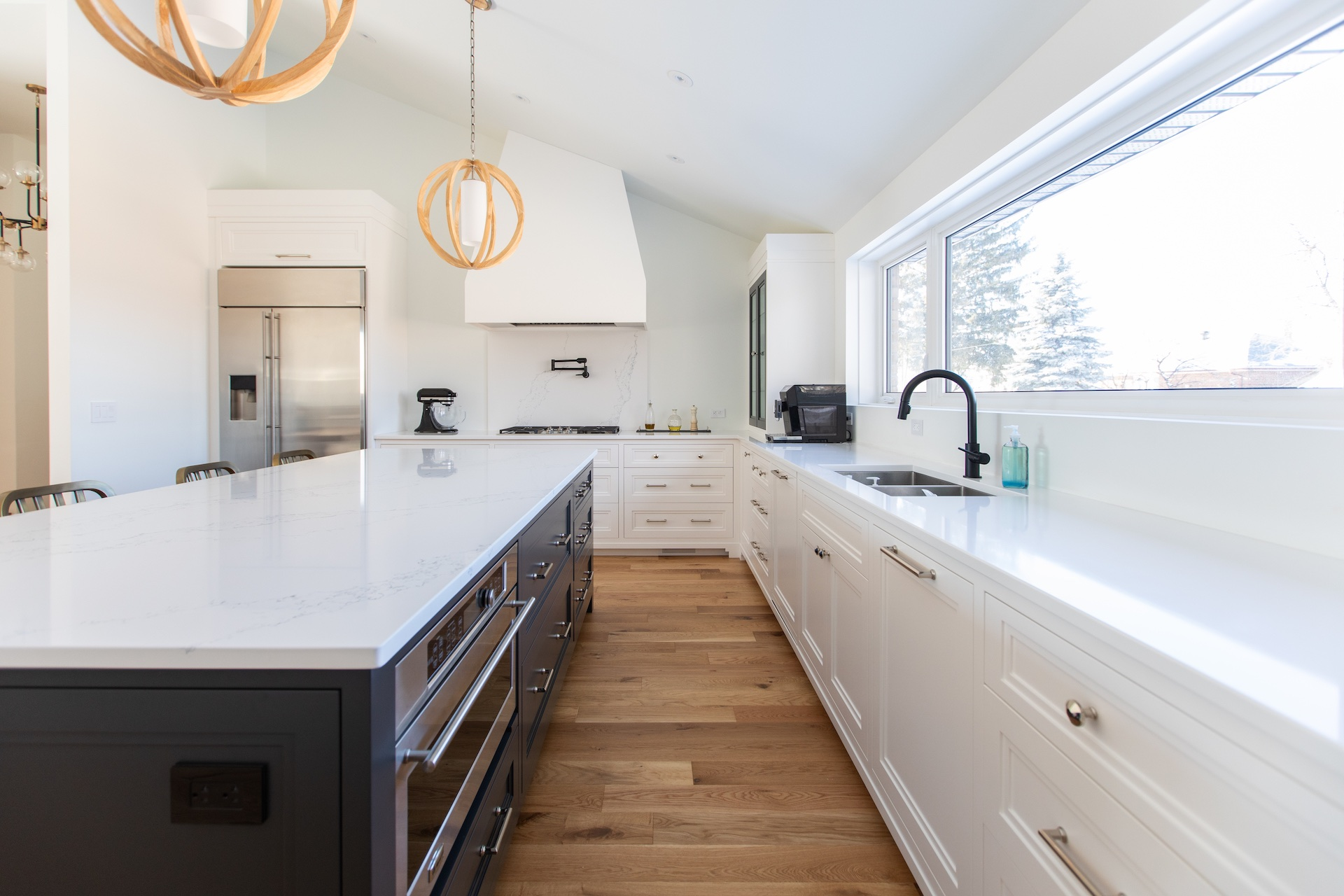 Blue island with white kitchen cabinets