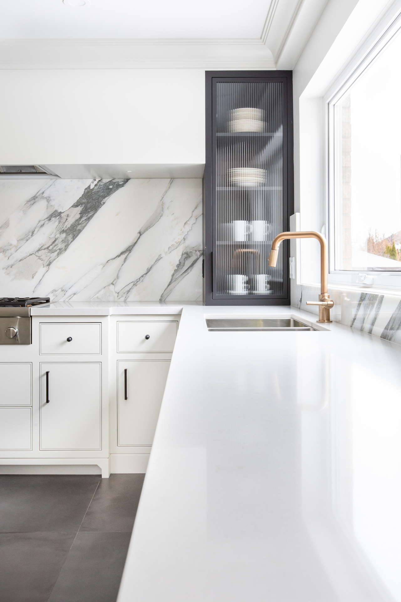white counter with gold sink