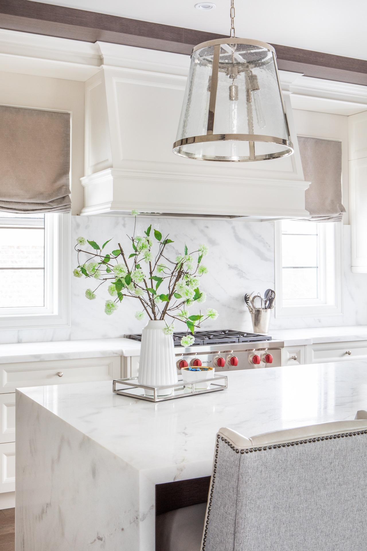 White kitchen island with plant