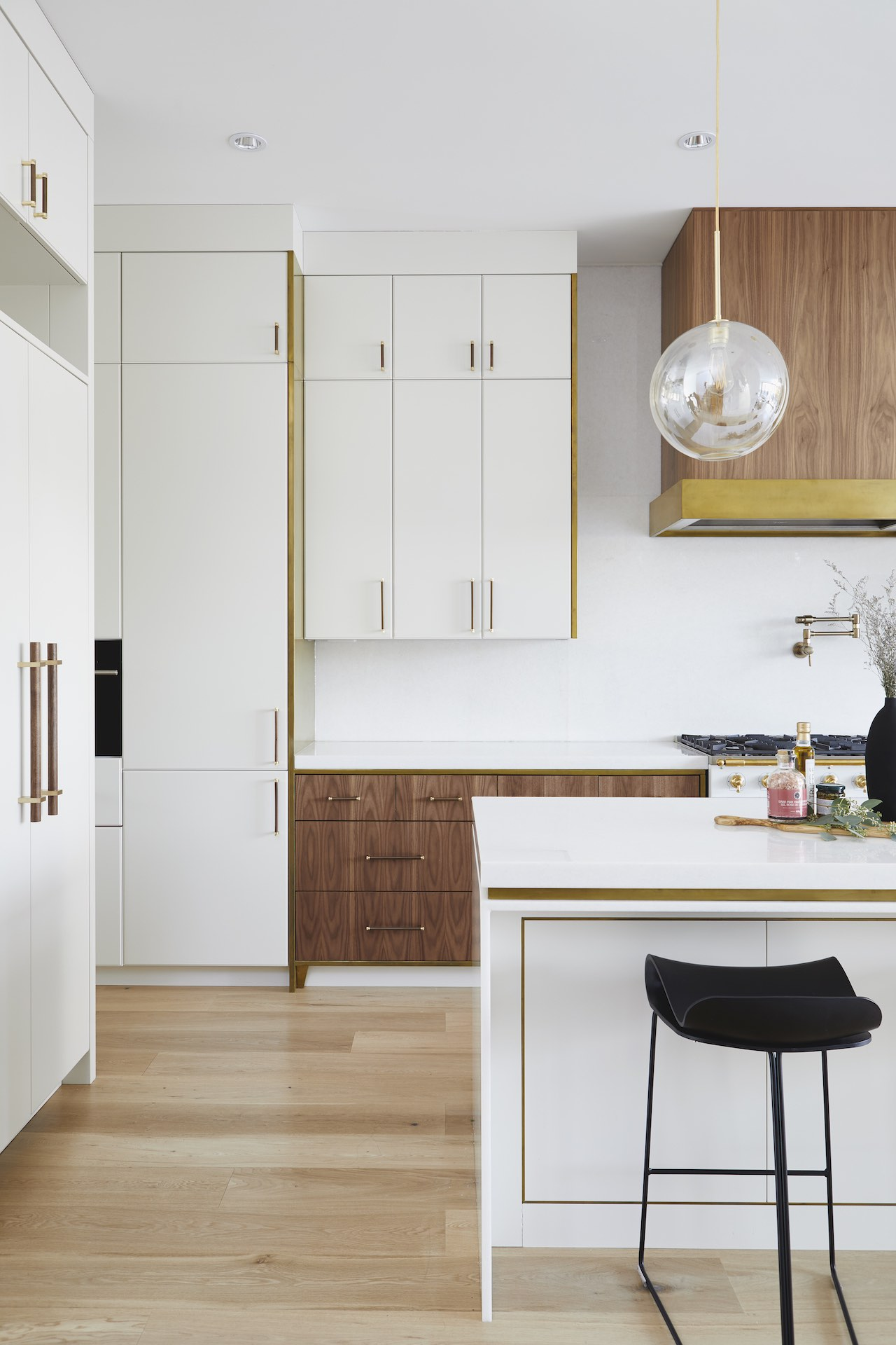 natural and white kitchen with black stools