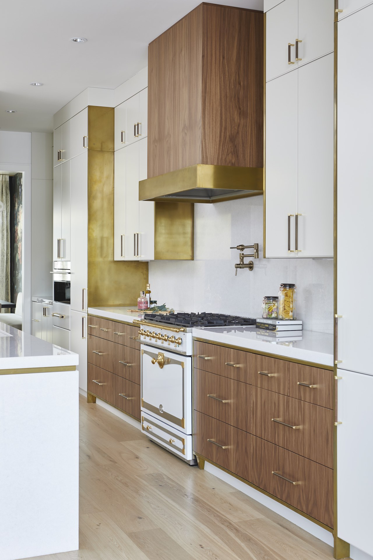 Natural wood and white kitchen with gold hardware