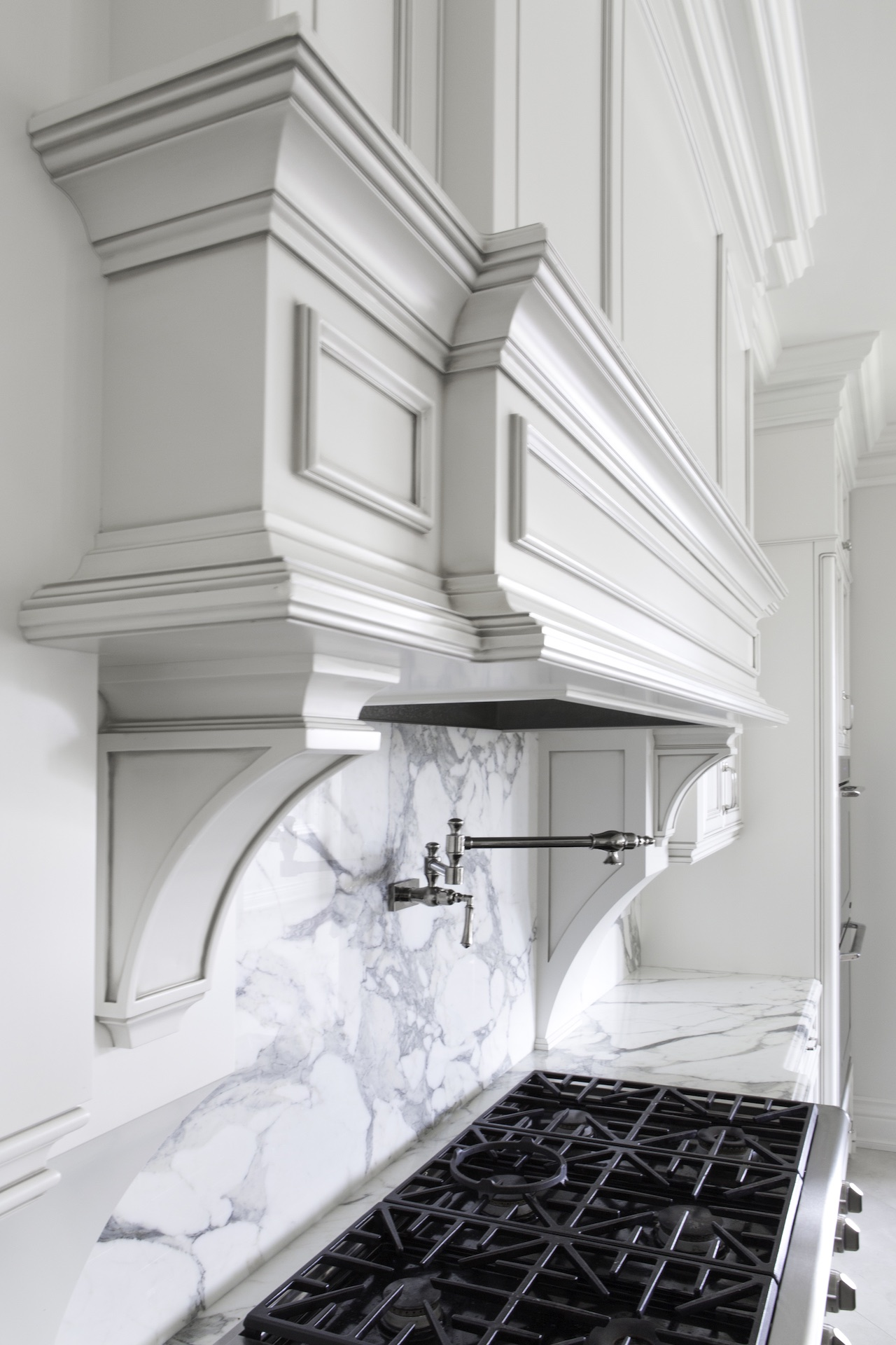stove and white wood hoodfan