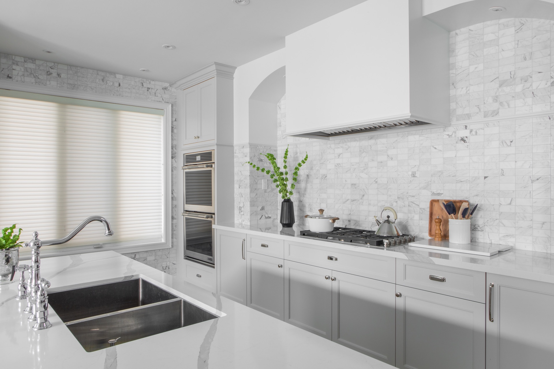 white kitchen with sink and stove