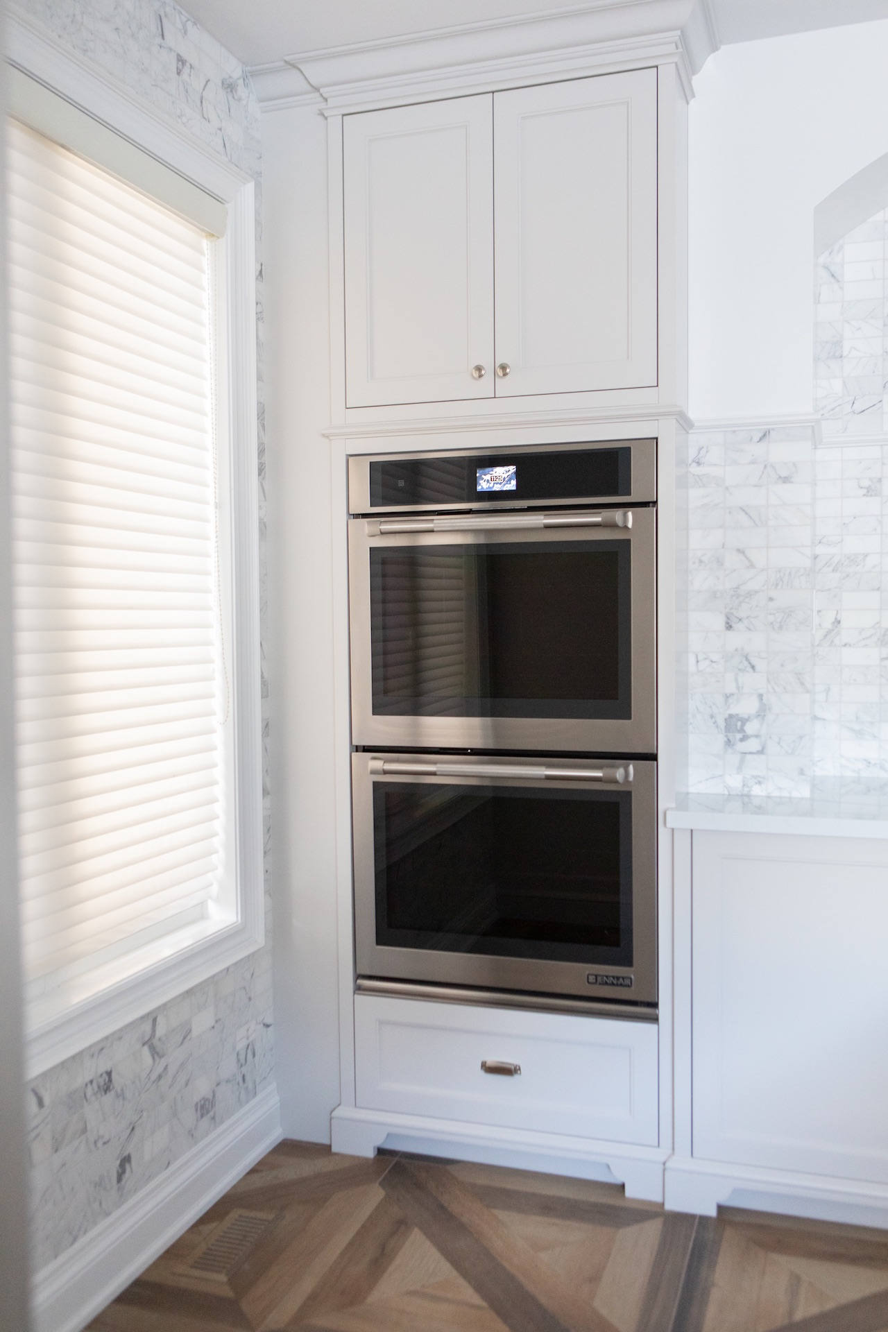white cabinets with oven