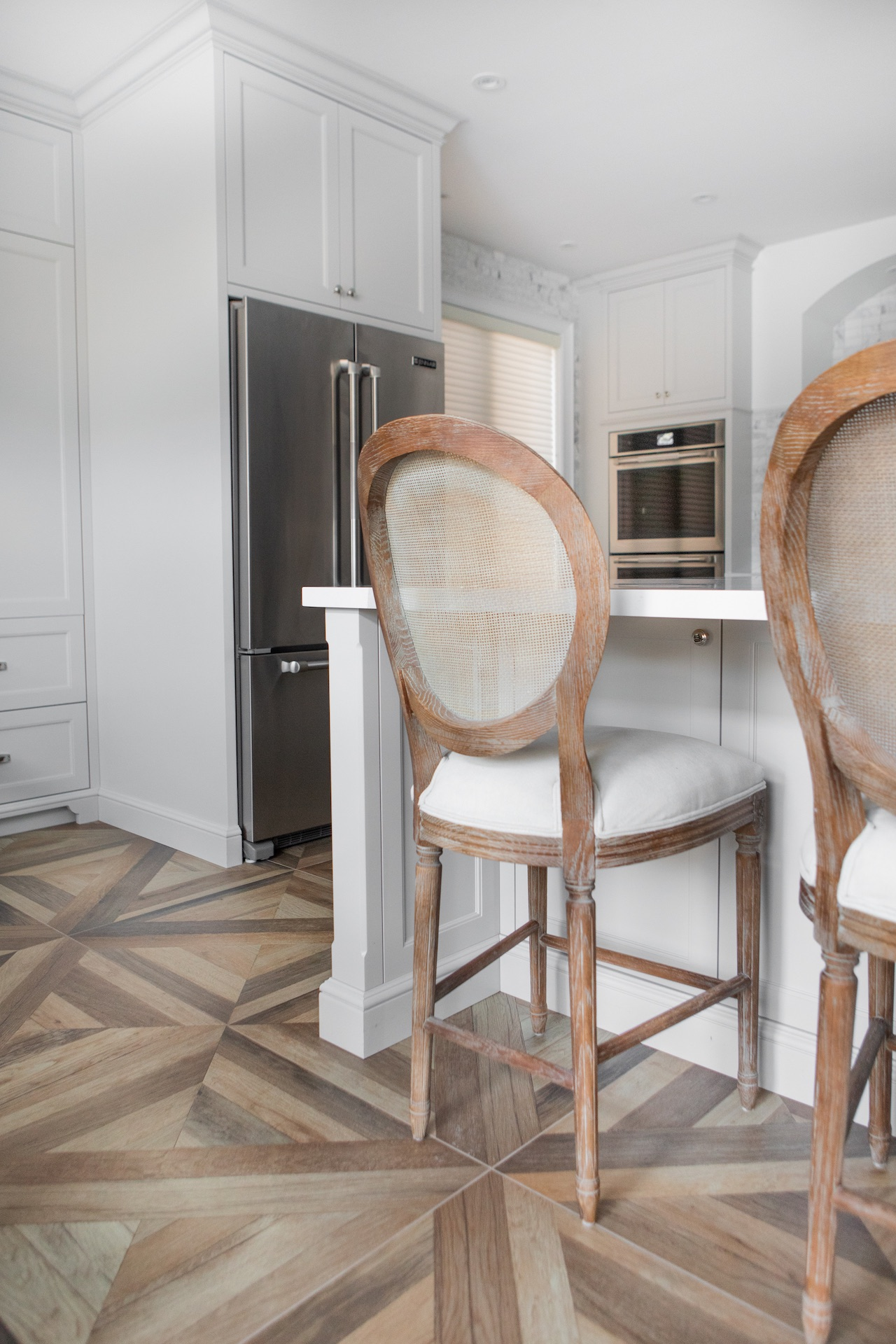 Wood floor with white and wood bar stools