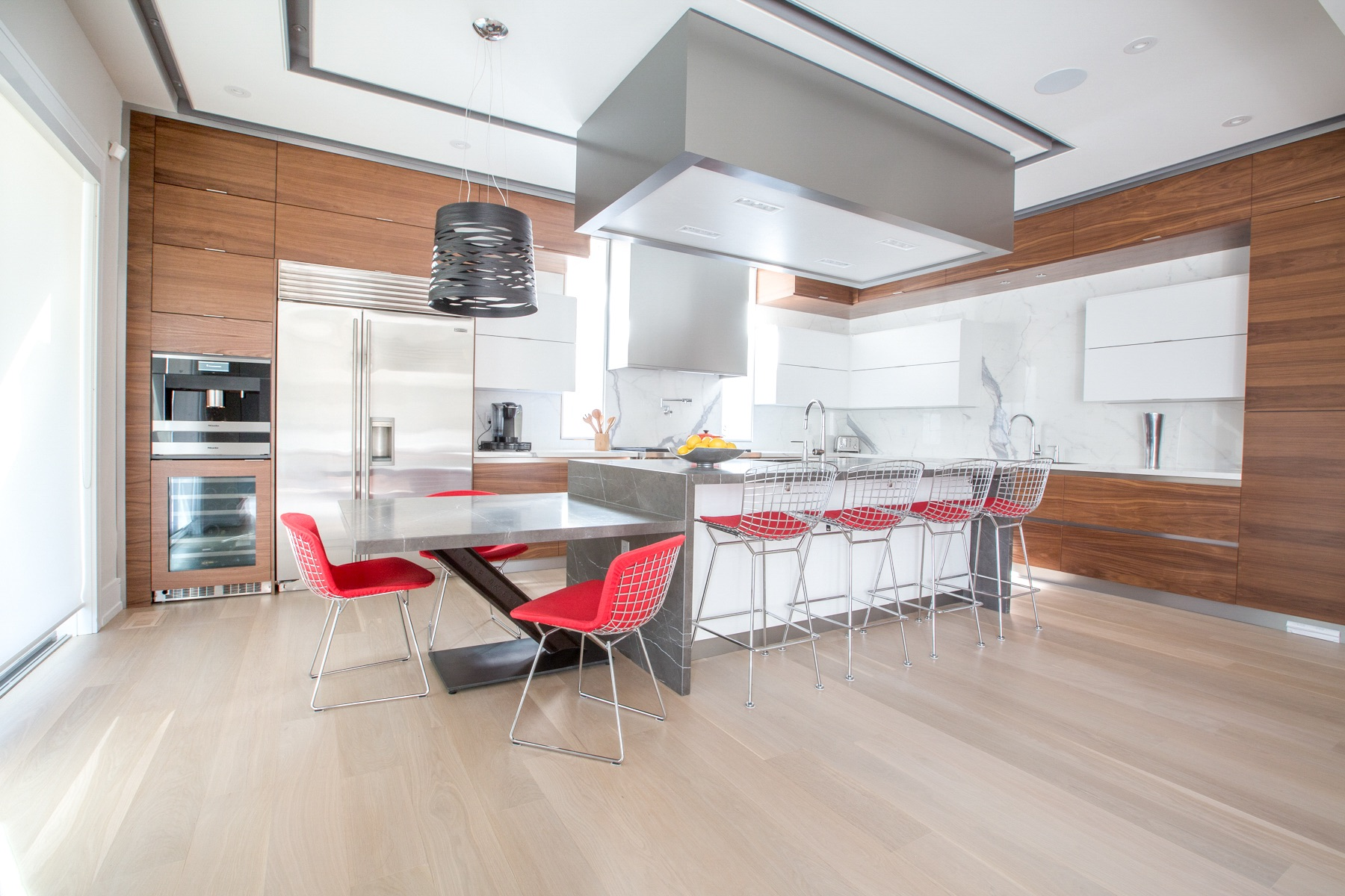 wood contemporary kitchen with red chairs