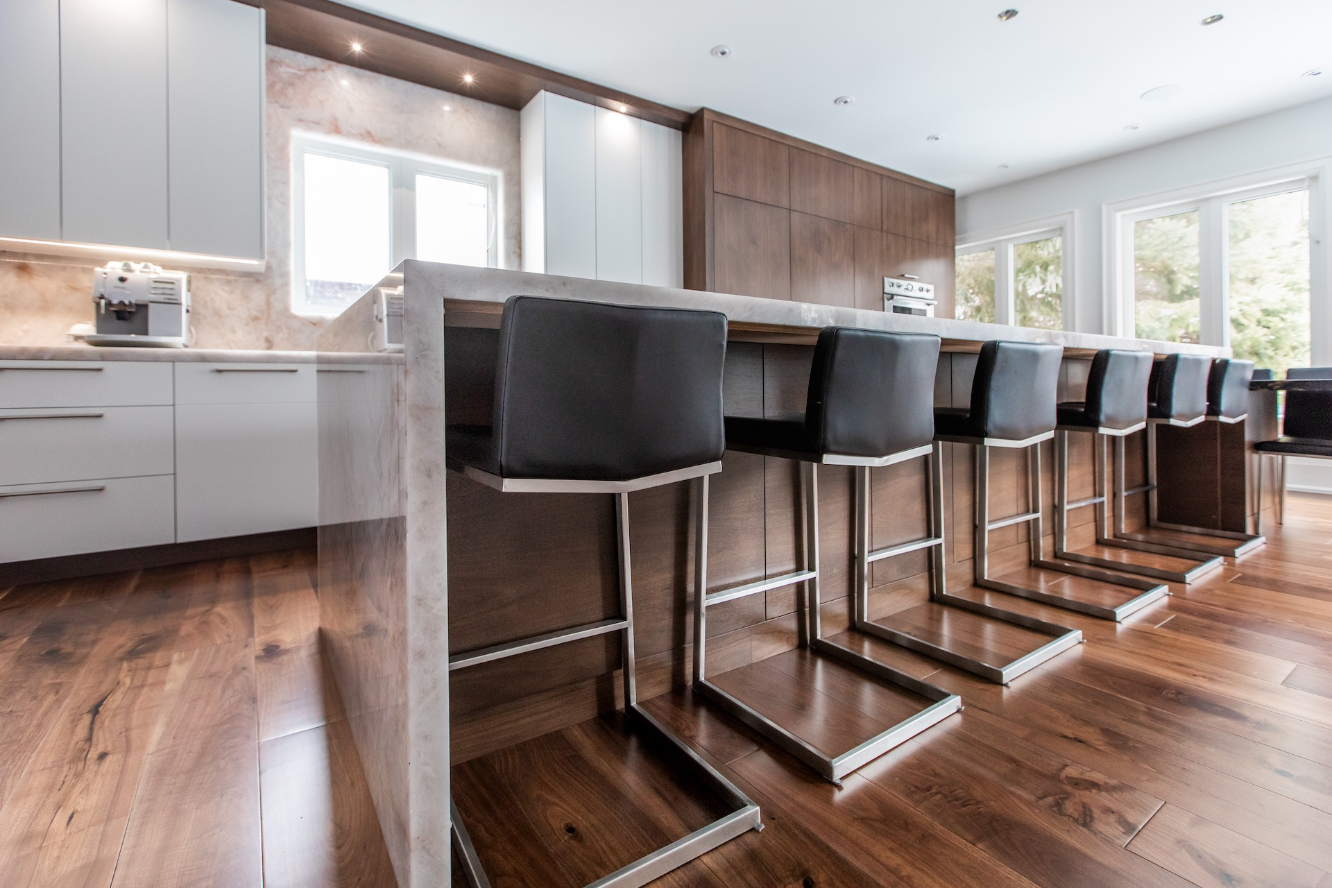 black bar stools on island