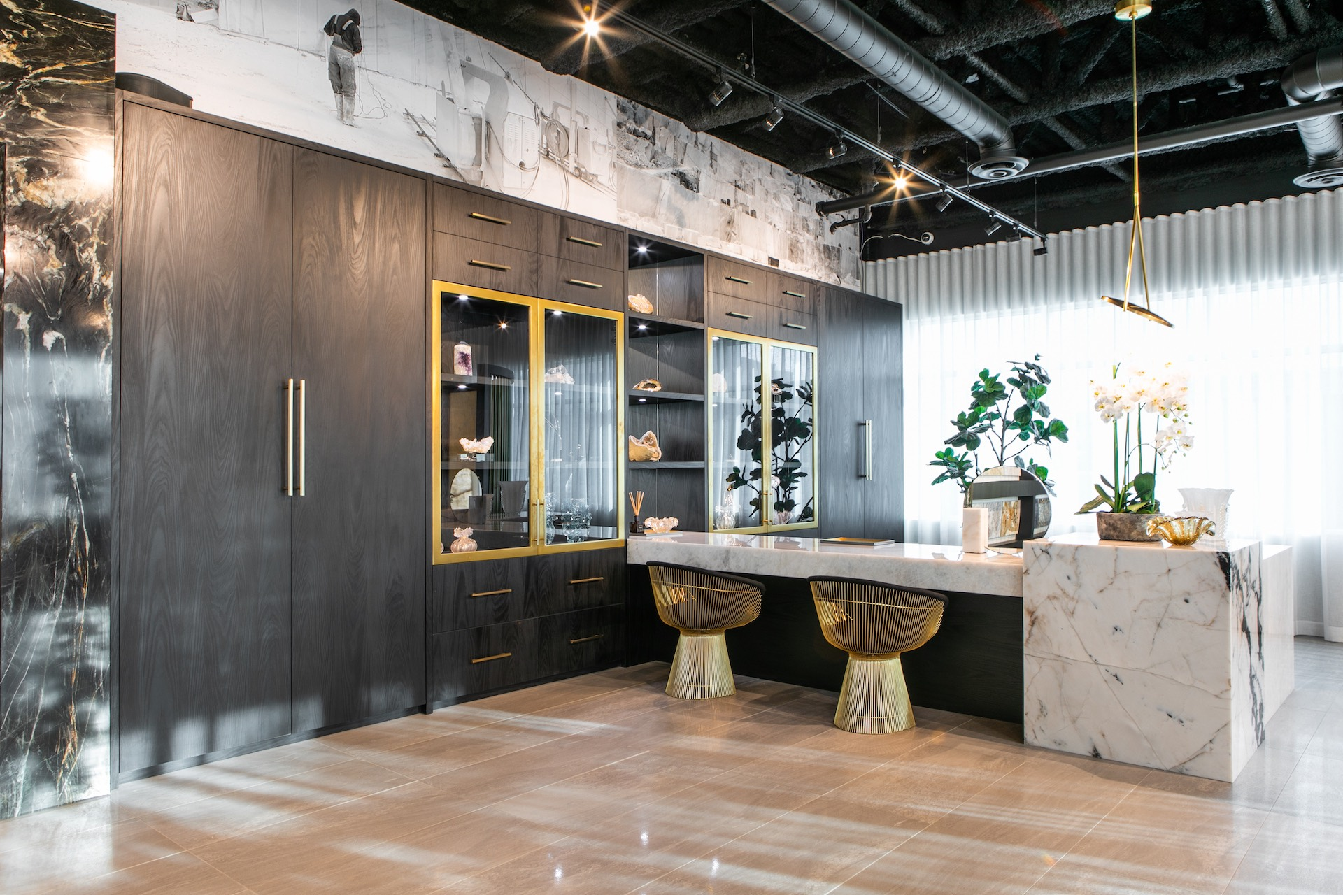 Grey cabinets with white marble bar and stools
