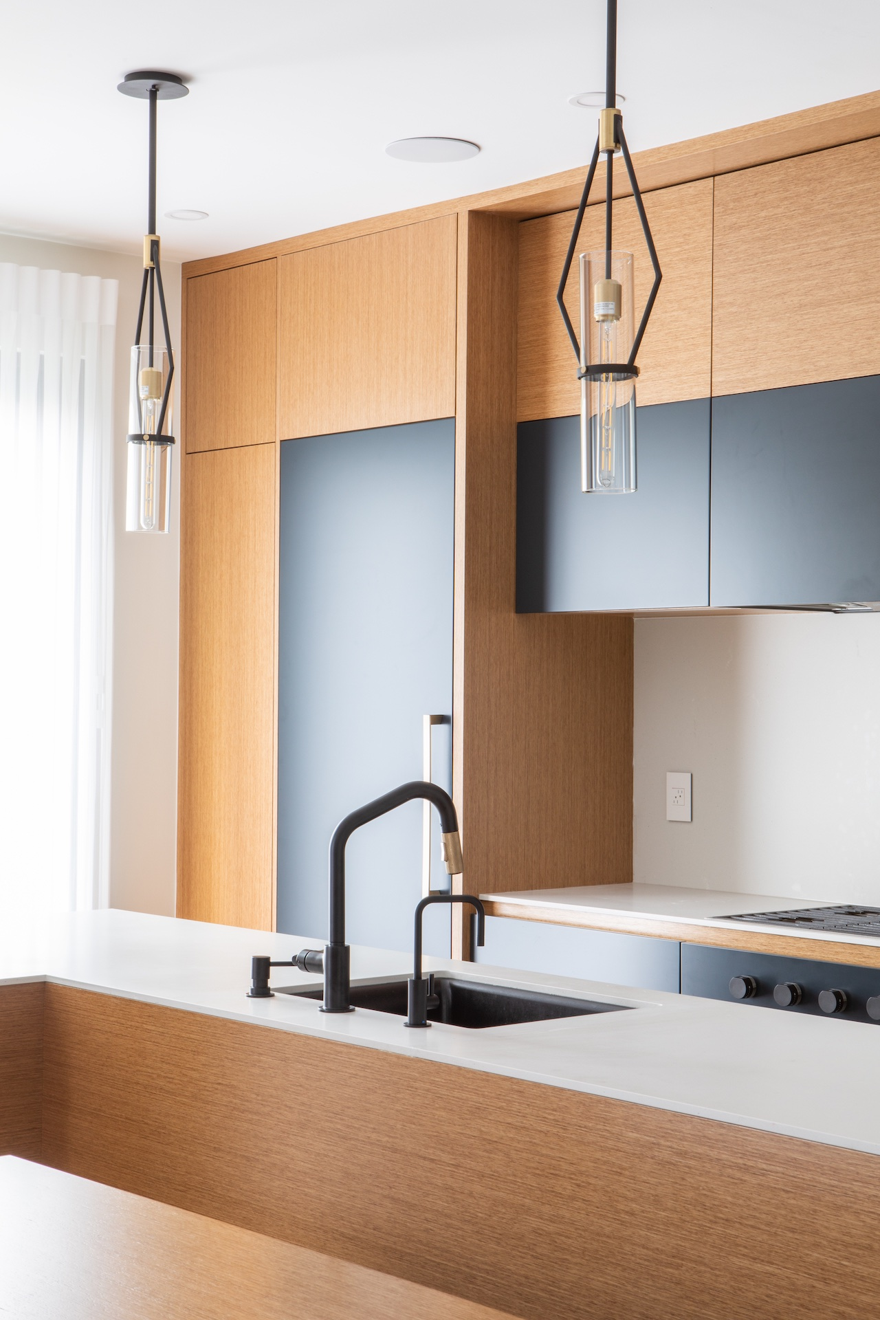 Natural wood and blue contemporary kitchen with black sink