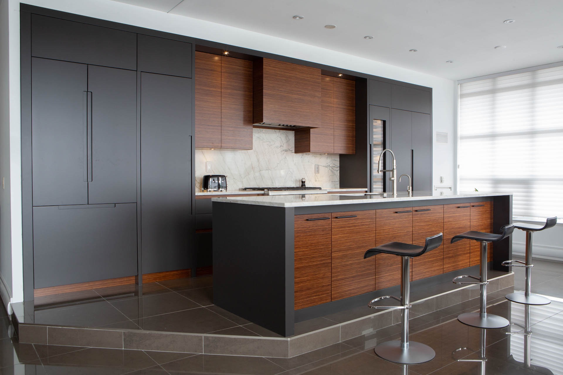 dark and light wood kitchen with bar stools