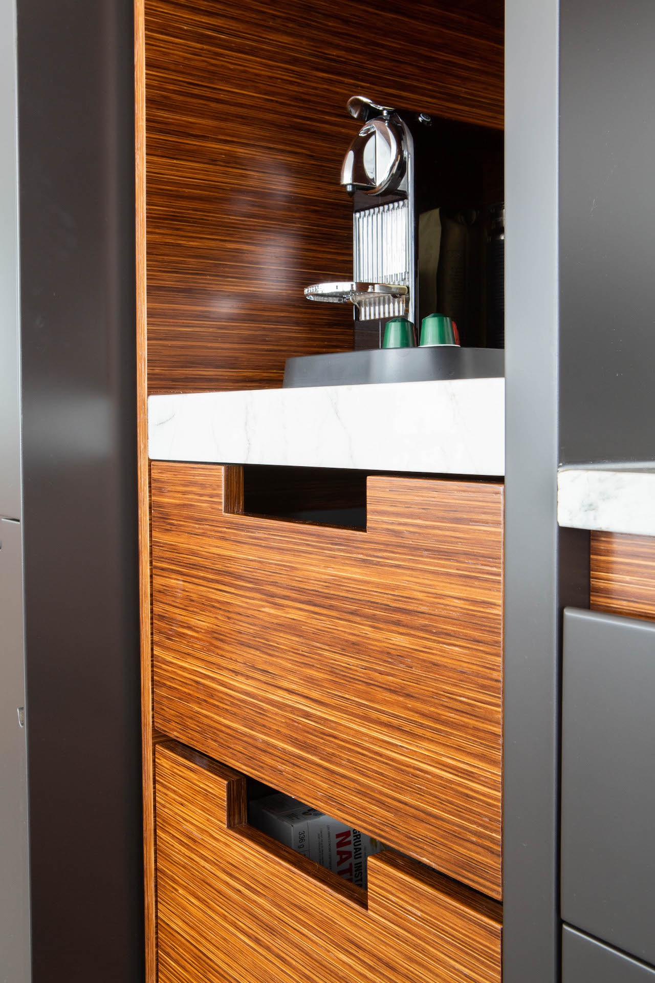 open cabinet with wood drawer and espresso machine