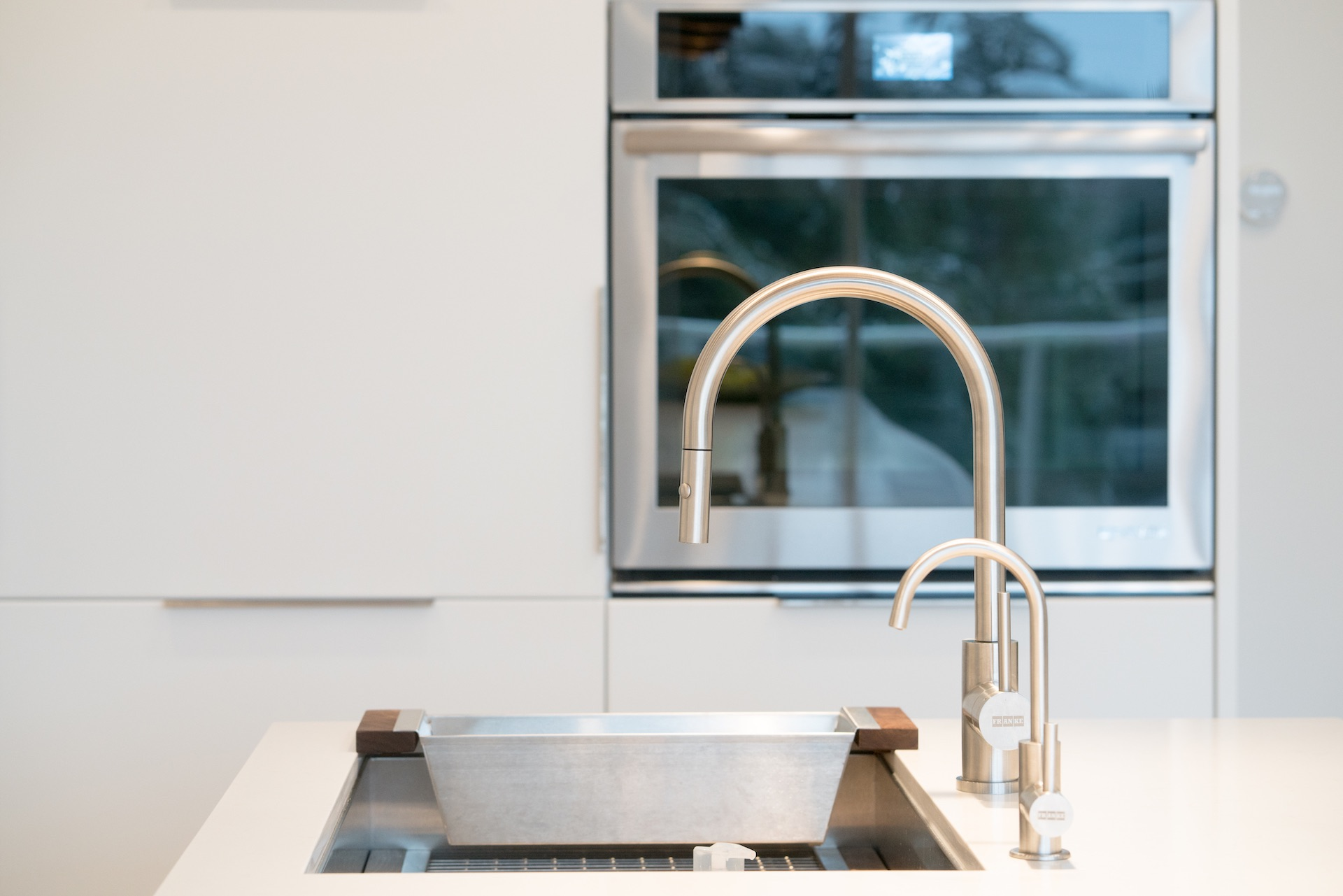 kitchen sink with silver faucet