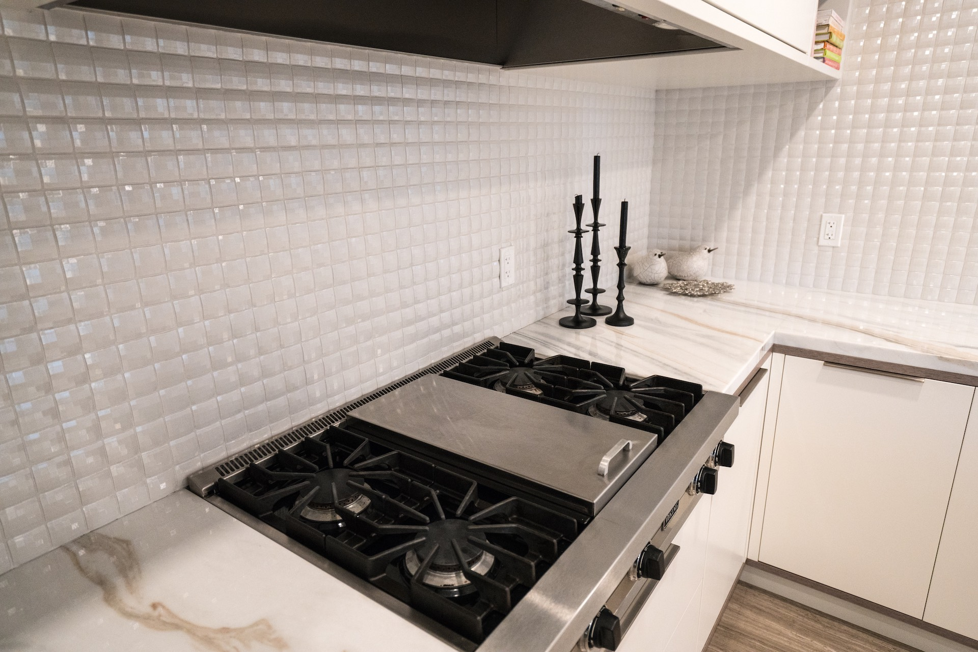 kitchen stove with white counters and backsplash