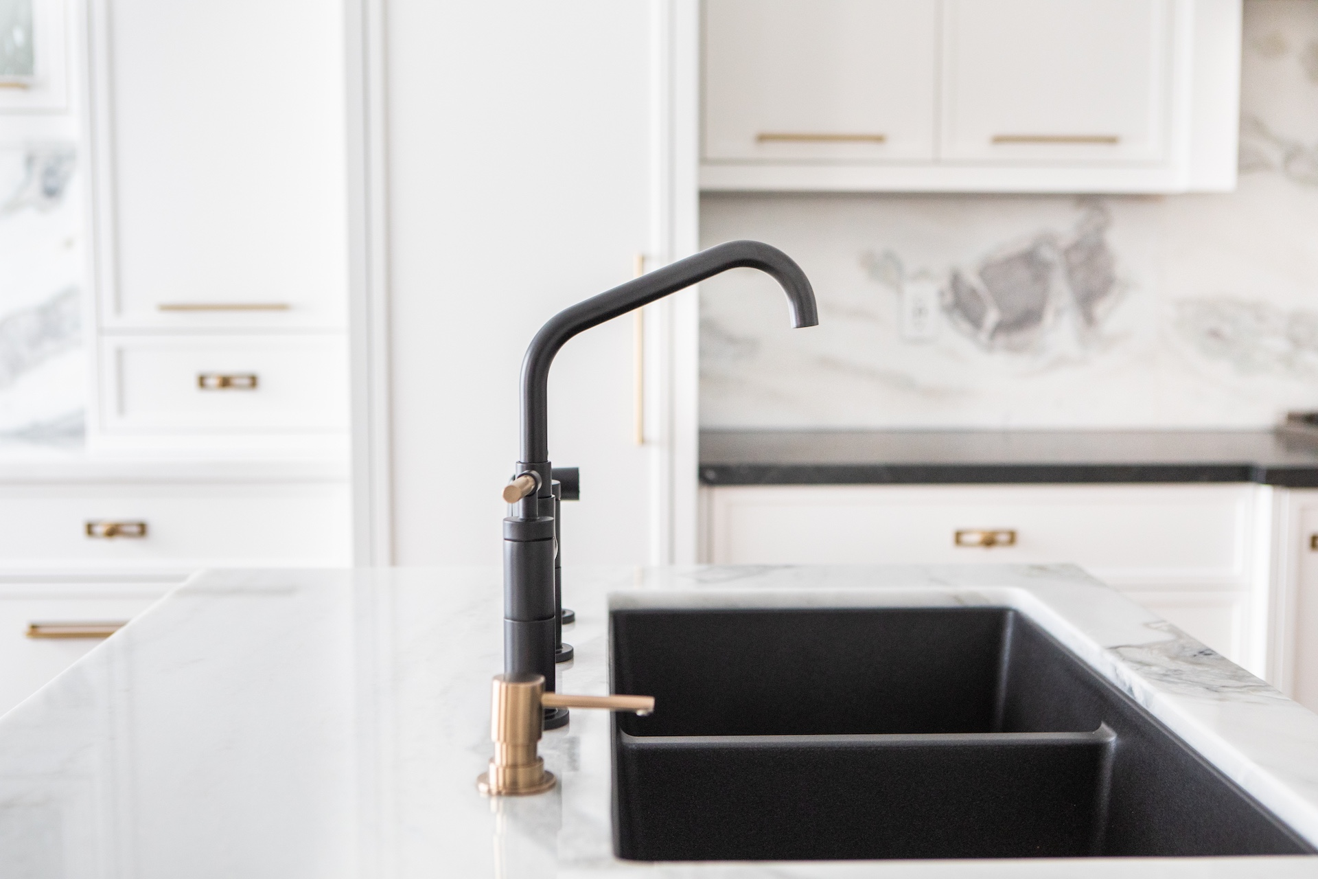 black and gold sink in white kitchen
