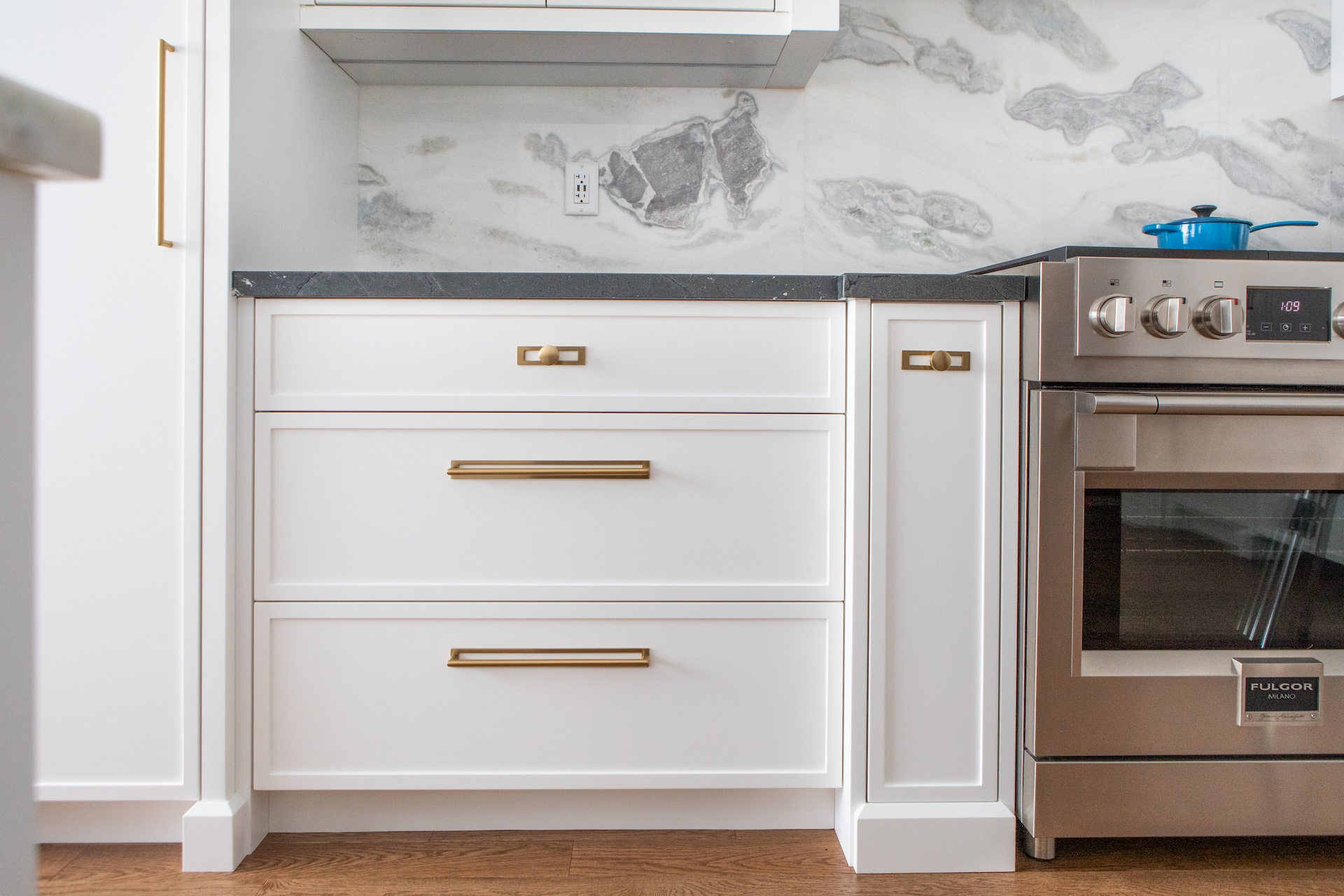 White kitchen with gold hardware and oven