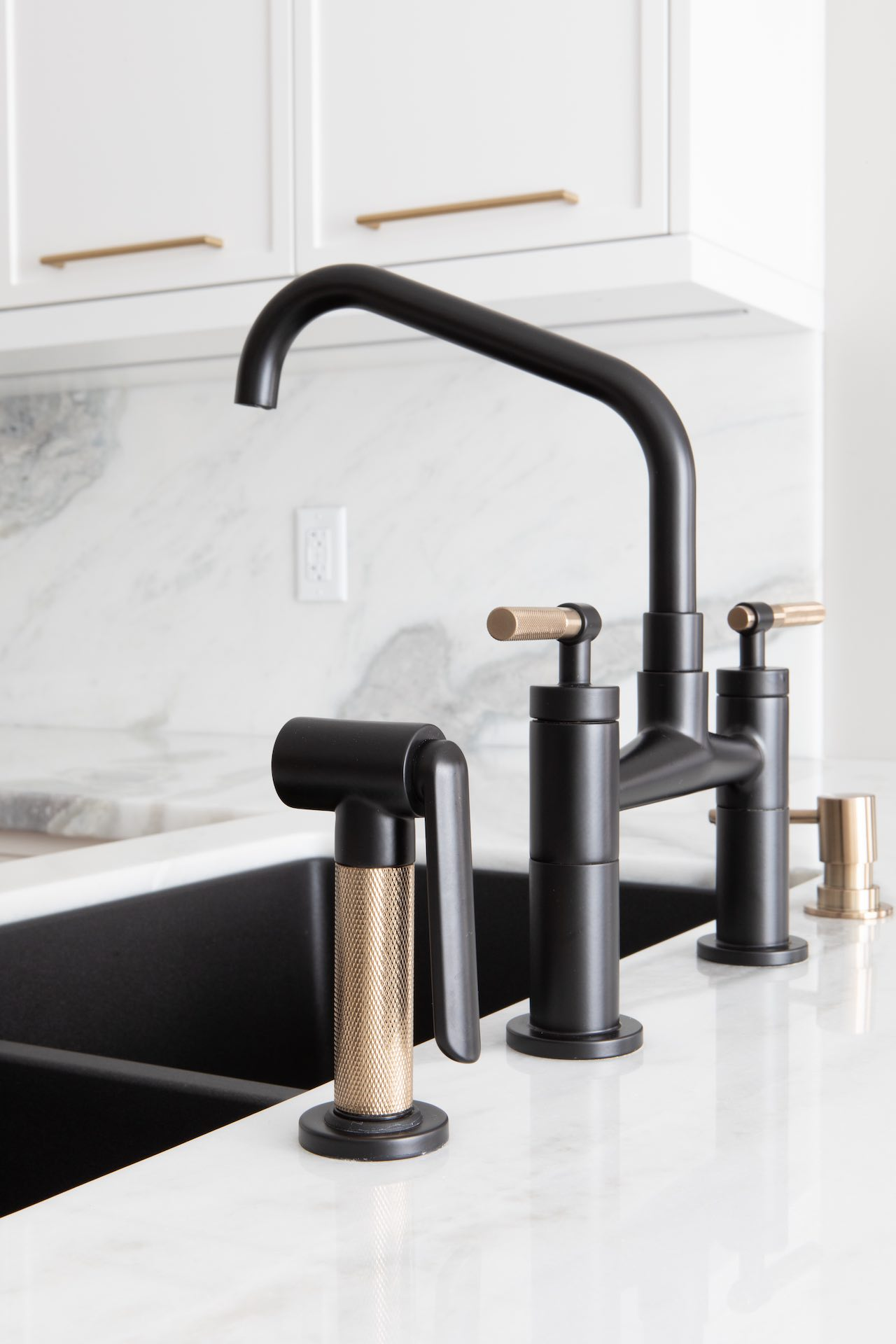 Black and gold kitchen faucet