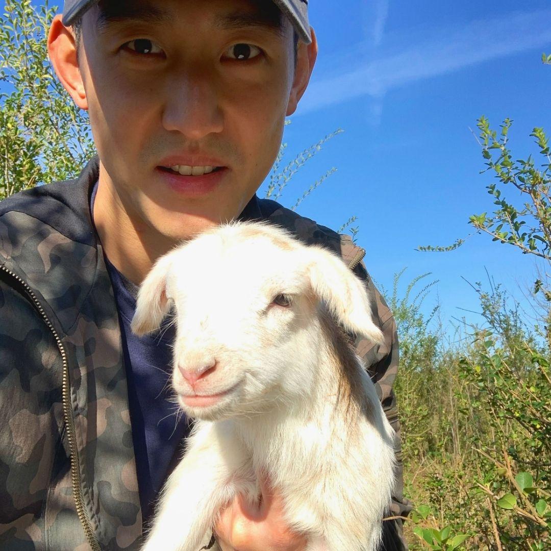 Future farmer holding a lamb