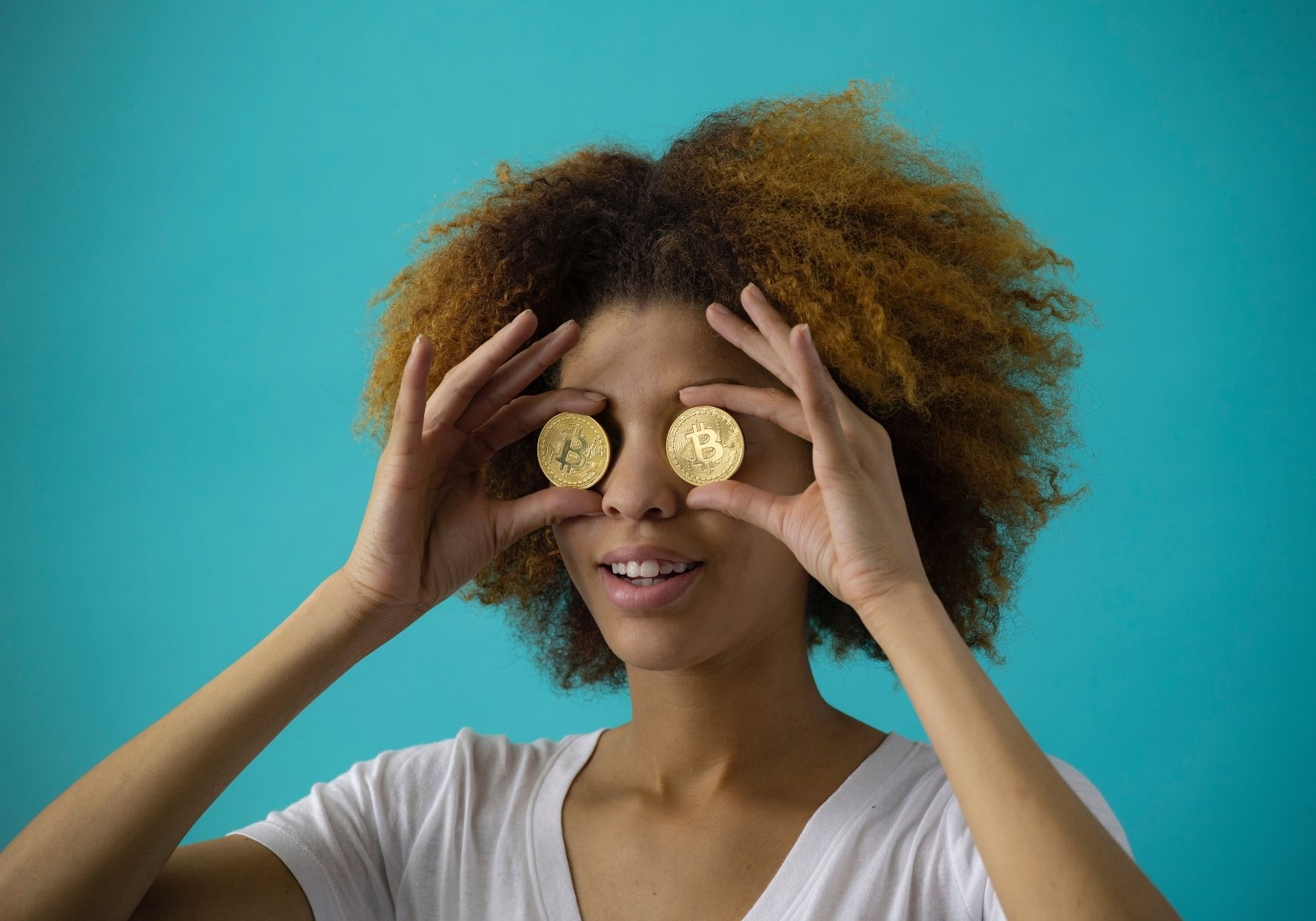 A Lady With Bitcoins In Front Of Her Eyes