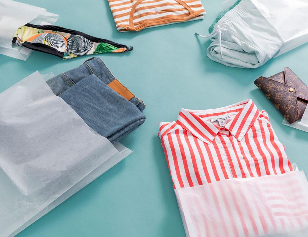 Scattered apparel inside of Vela bags