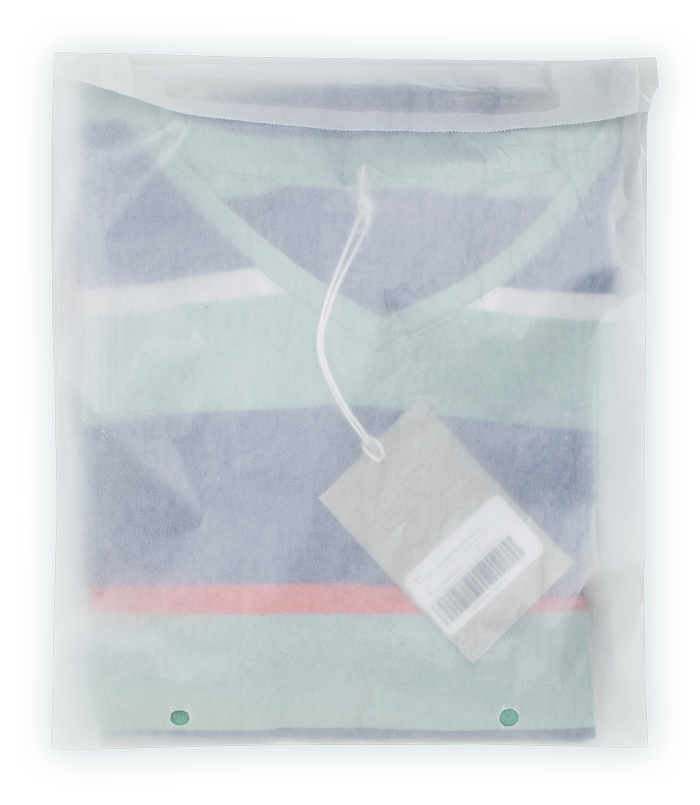 A shirt loaded in a Vela bag showing off resealable strip, gussets, and vent holes