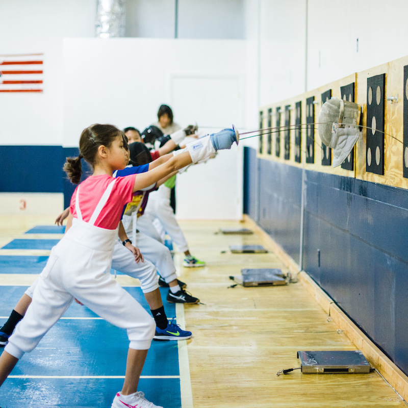 youth fencing class, kids hitting target