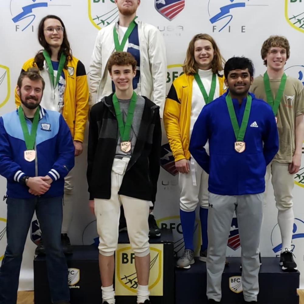 teen fencers on podium
