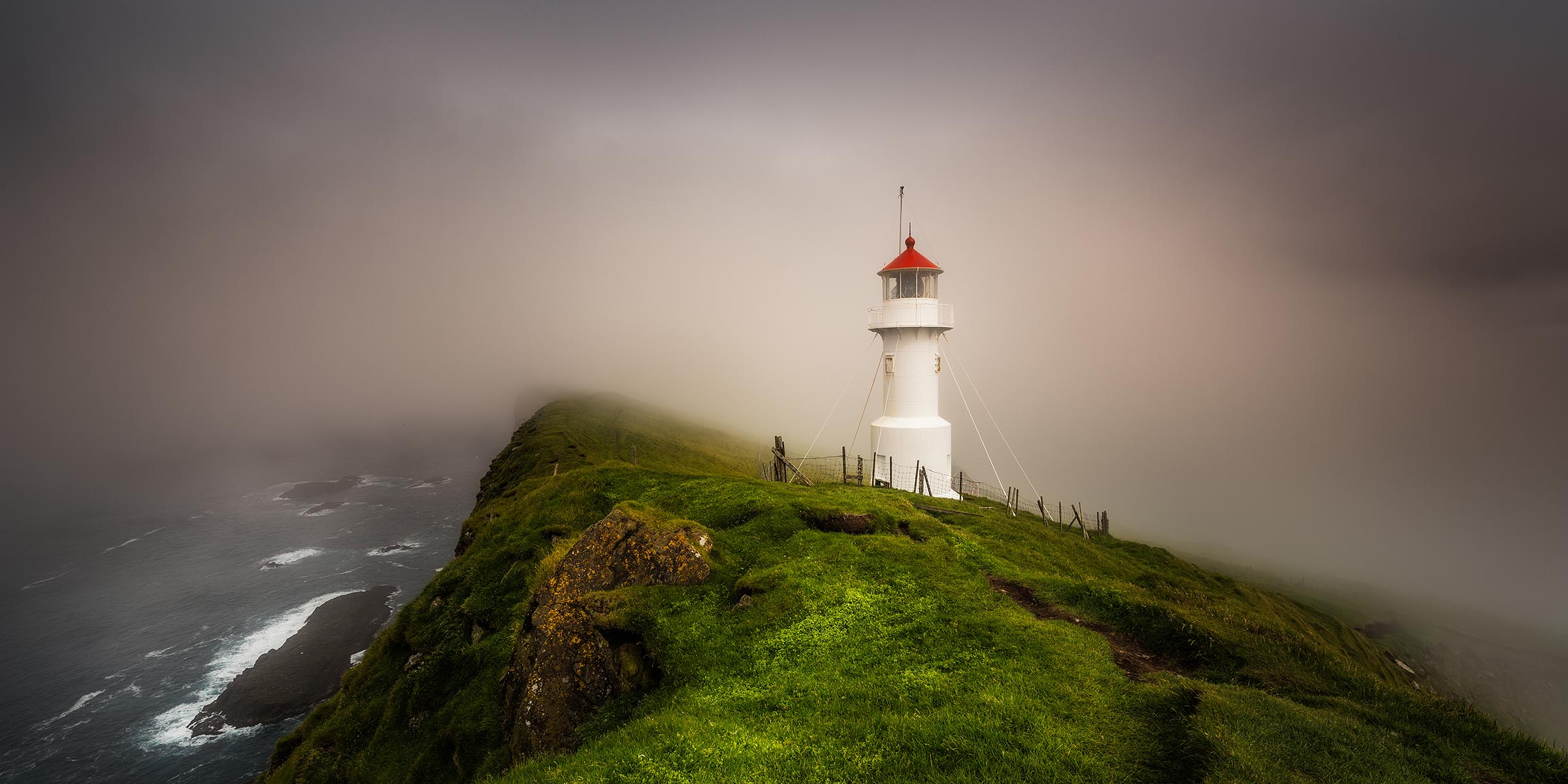 Photograph of Mykines Lighthouse in Mykines, Faroe Islands by Brent Goldman Photography