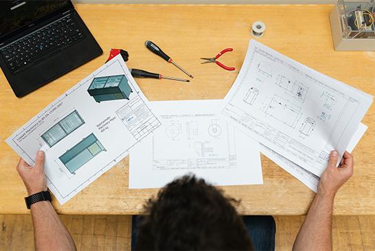 engineer looking over design