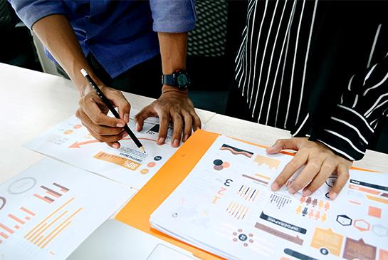 Two people reviwing analytics