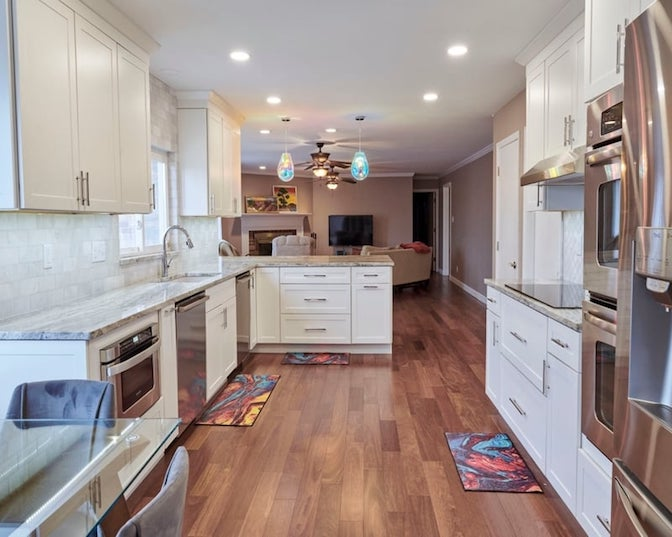 Updated, open-concept kitchen that supports the daily needs of a family of six.
