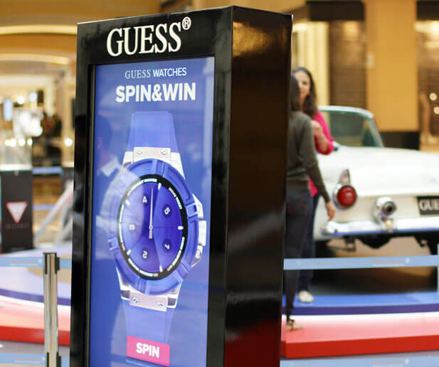 Guess Watches Spin & Win Stand
