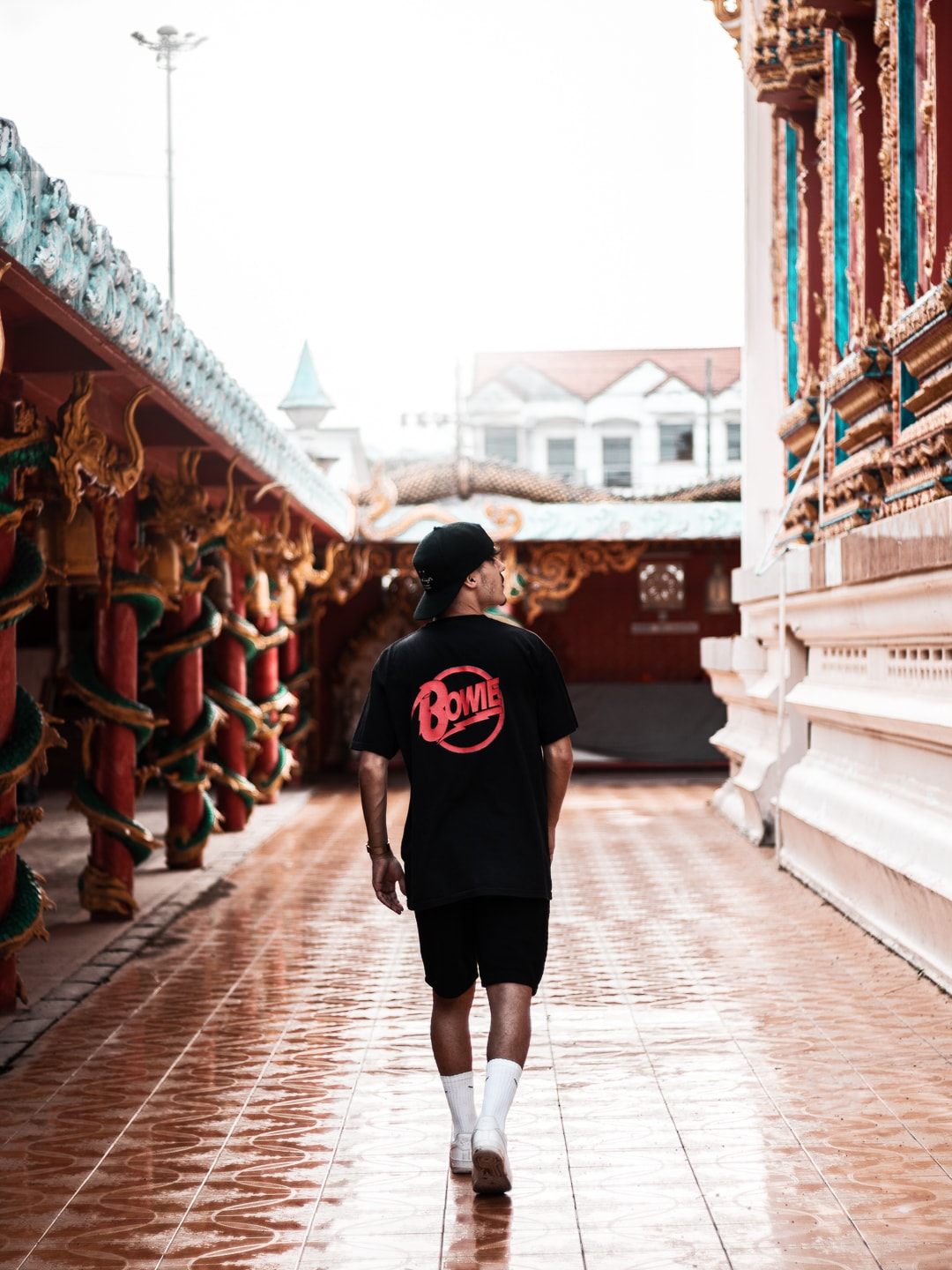 Athos Abreu walks into a temple in Phuket, Thailand and looks up to the right.