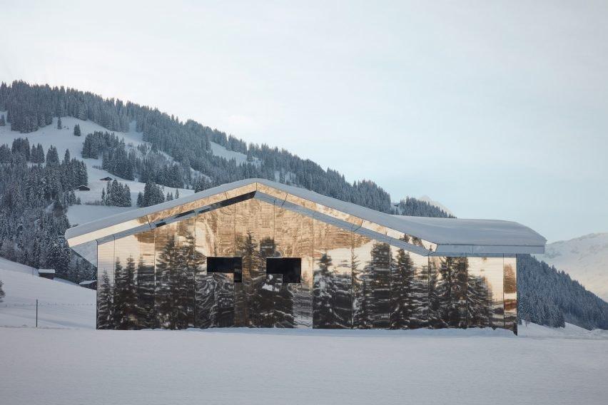 Mirage Gstaad mirrored building art installation by Doug Aitken in Switzerland in winter