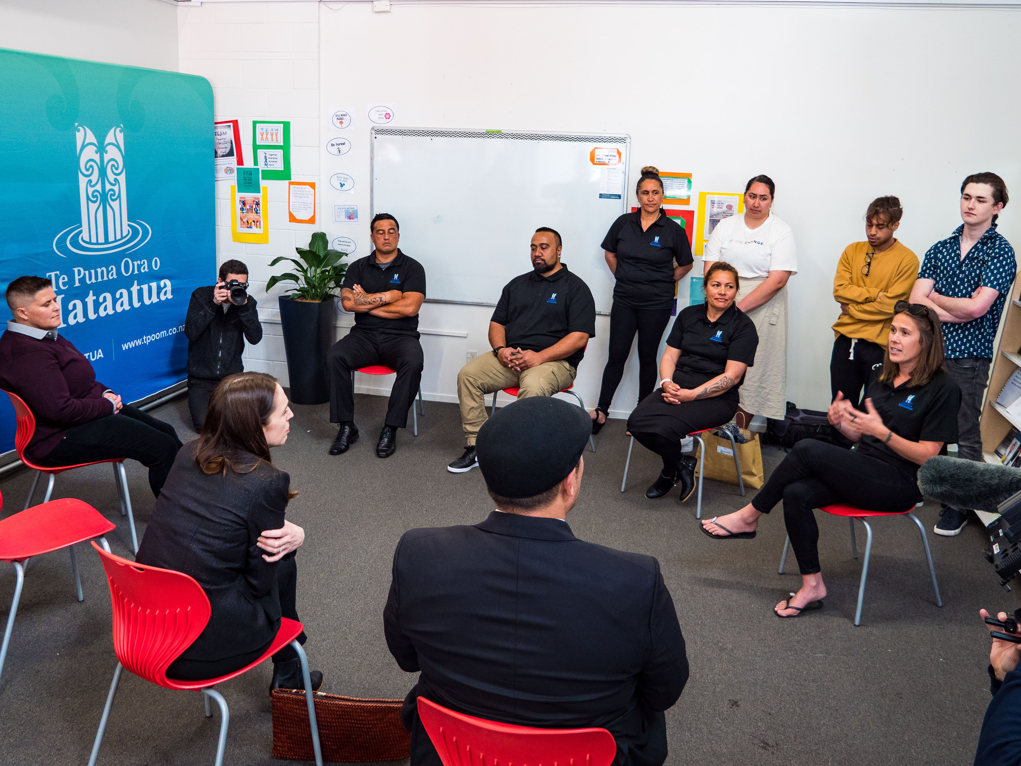 Prime Minister Jacinda Arden listening to group of Te Puna Ora o Mataatua staff members