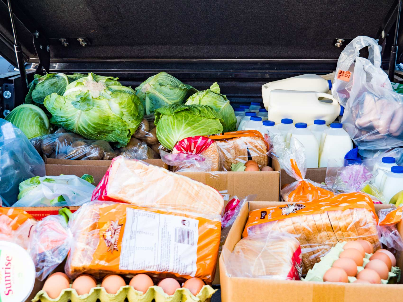 The trunk of a car filed with food