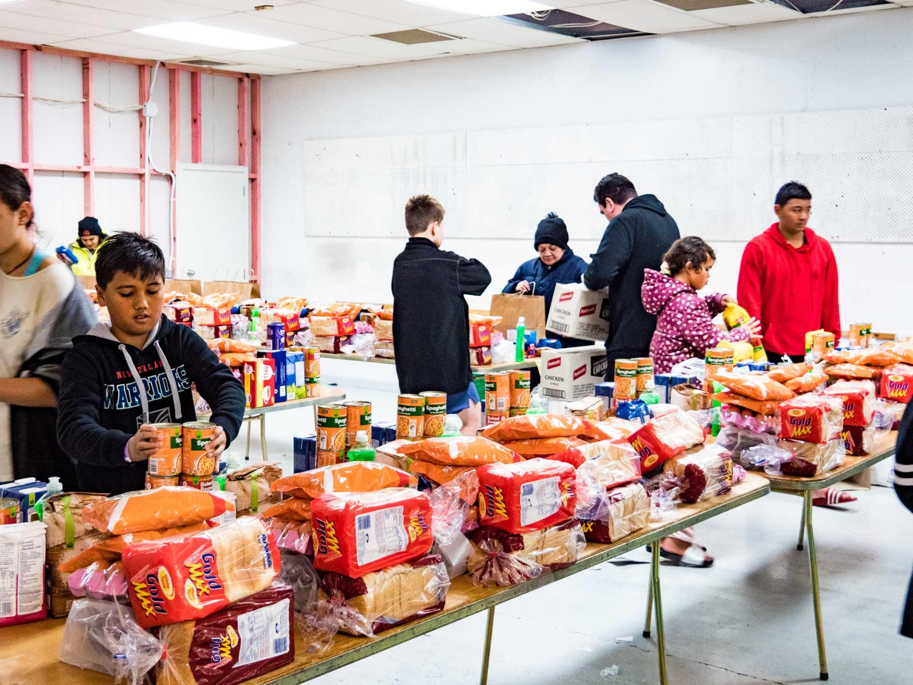 Children help prepare food parcels