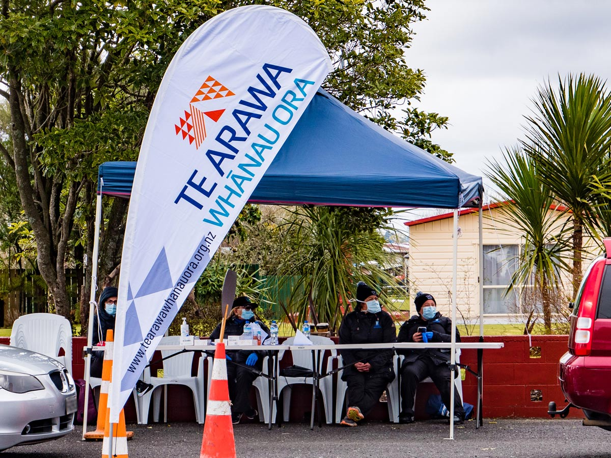 Te Puna Ora o Mataatua staff seated under a tent