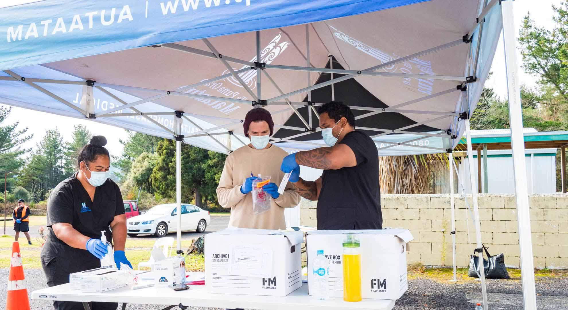 Health workers prepare Covid-19 Surveillance Testing samples