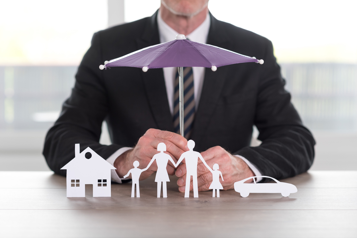 Insurance umbrella image for home, car, and family