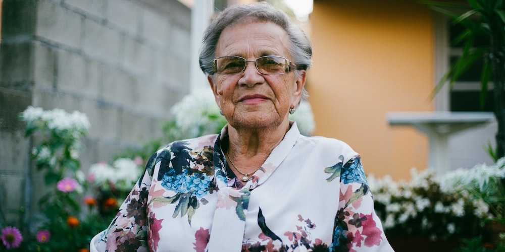 Older woman subtly smiling at camera