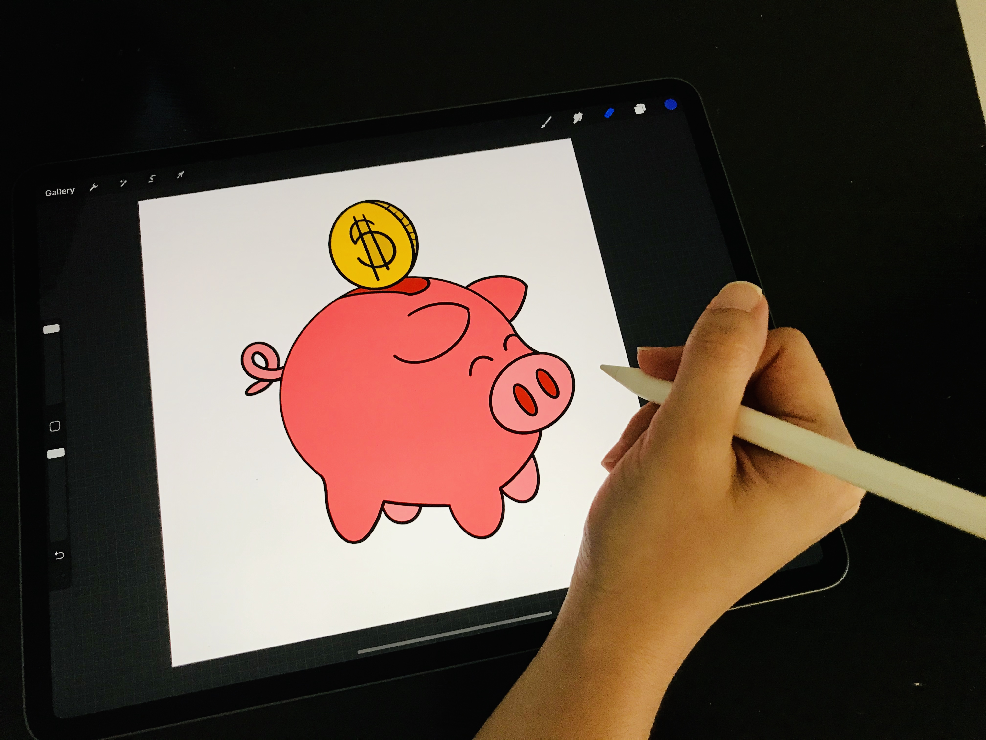 An ipad with a picture of a cartoon piggy bank and golden coin being inserted into it.