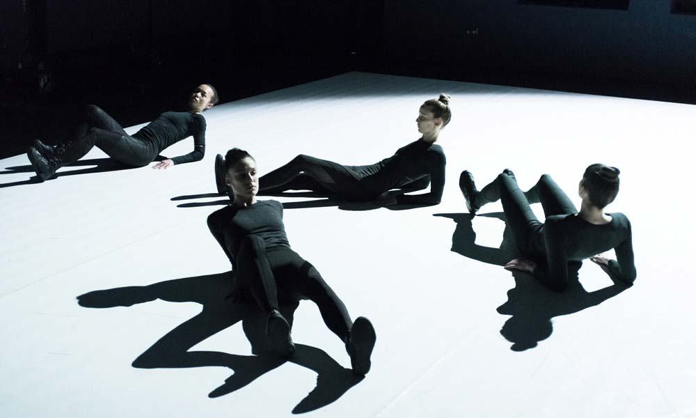Four contemporary dancers during extraordinary Vis Motrix performance from CocoonDance company.