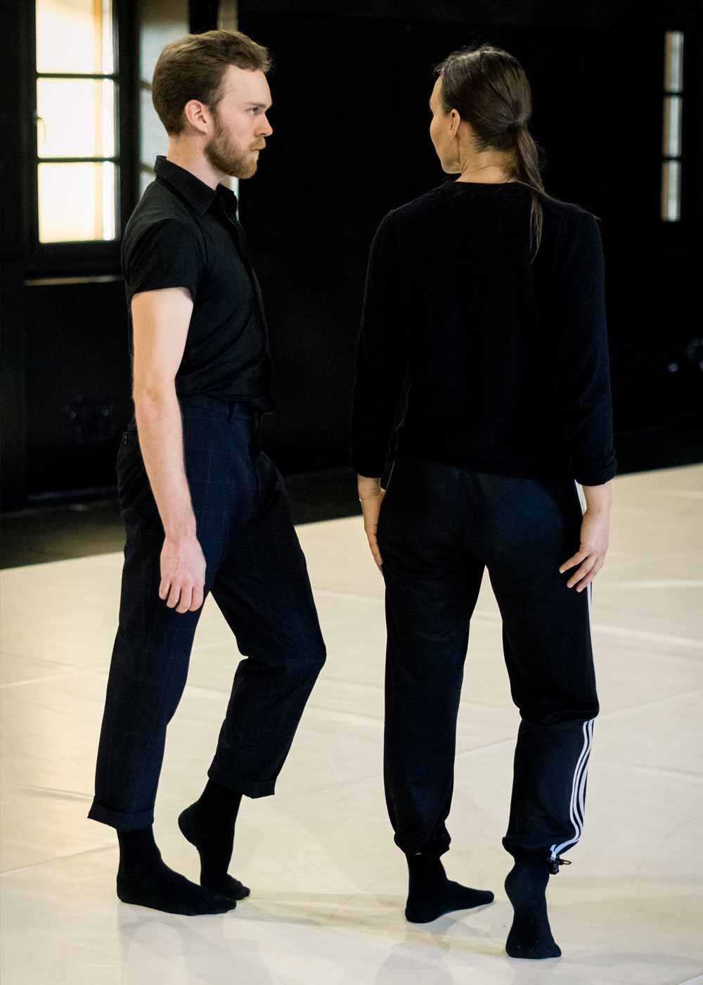 Anna Kempin and a male dancer looking at each other and WIlder Shores rehearsal, composed by Michèle Murray