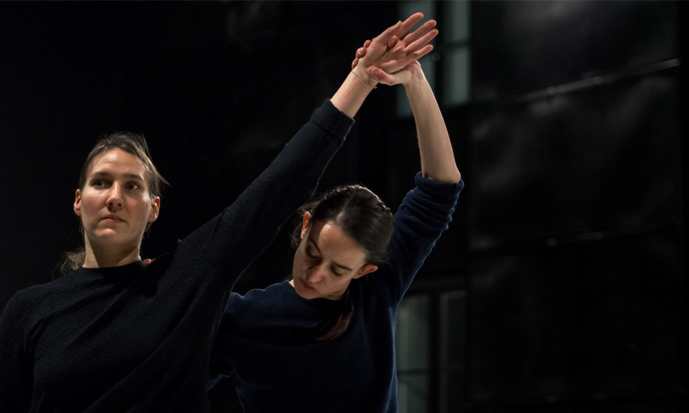 Anna Kempin and other dancer are captured during a rehearsal