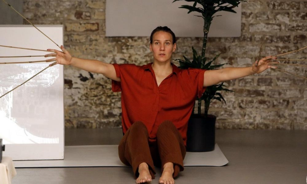 Anna Kempin captured performing at Atlas 2 contemporary dance project while sitting on the ground